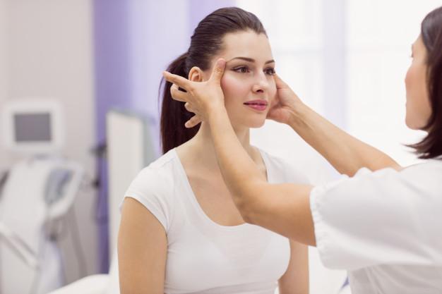 dermatologist-examining-female-patient-skin_107420-65509