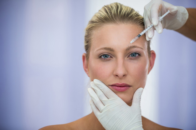 female-patient-receiving-botox-injection-forehead_107420-74095